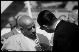 Srila Prabhupada is interviewed by a news reporter
